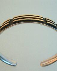Armband-smal-bicolor-zilver-18krt.-ZIJaanzicht